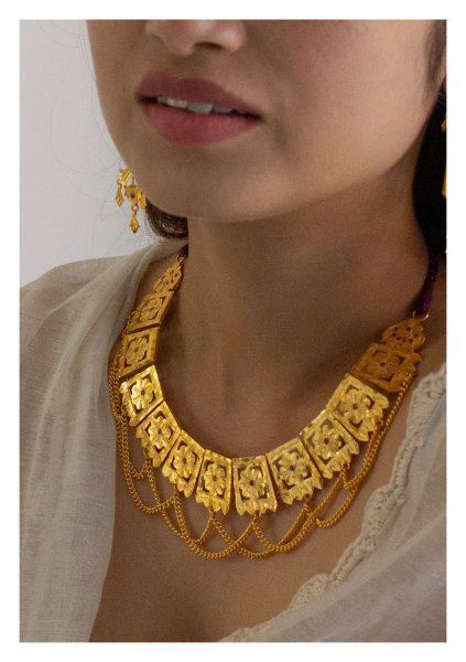Bina Handmade Gold Tone Silver Necklace